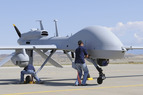 Workers prepare an MQ-1C Gray Eagle unmanned aerial vehicle for static display at Michael Army Airfield, Dugway Proving Ground in Utah in this US Army handout photo